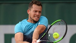 Adam Pavlasek breaks Ryan Harrison on four occasions to reach the second qualifying round at Roland Garros on Tuesday.