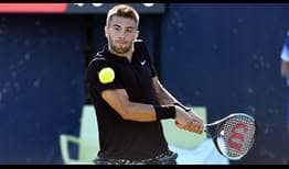 Borna Coric saves one match point to beat Cristian Garin at the Libema Open on Friday.