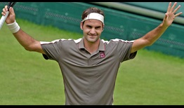 Roger Federer begins his pursuit of a 10th Halle title with a straight-sets victory against John Millman on Tuesday.