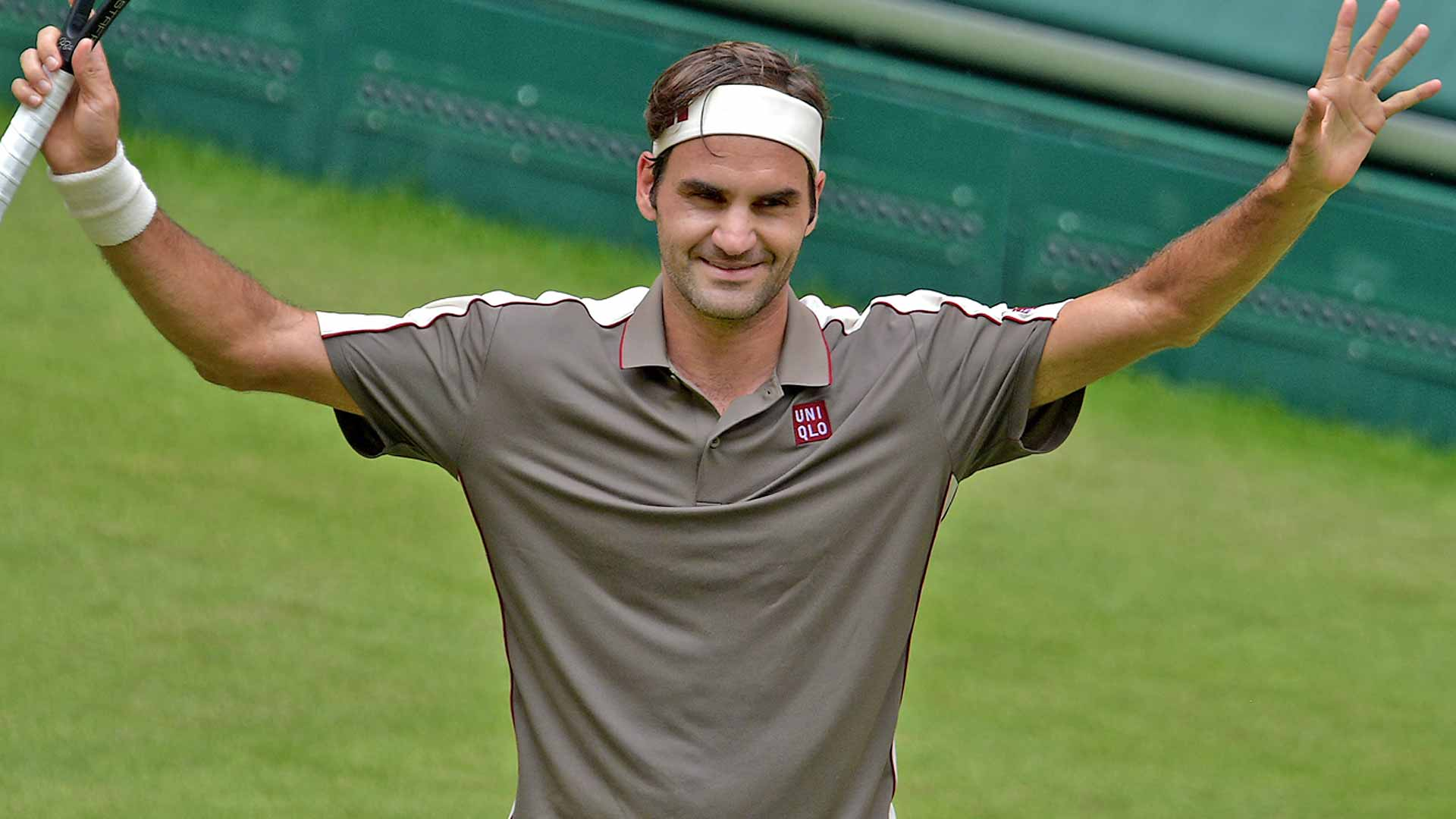 Roger Federer celebrates his first-round win in Halle