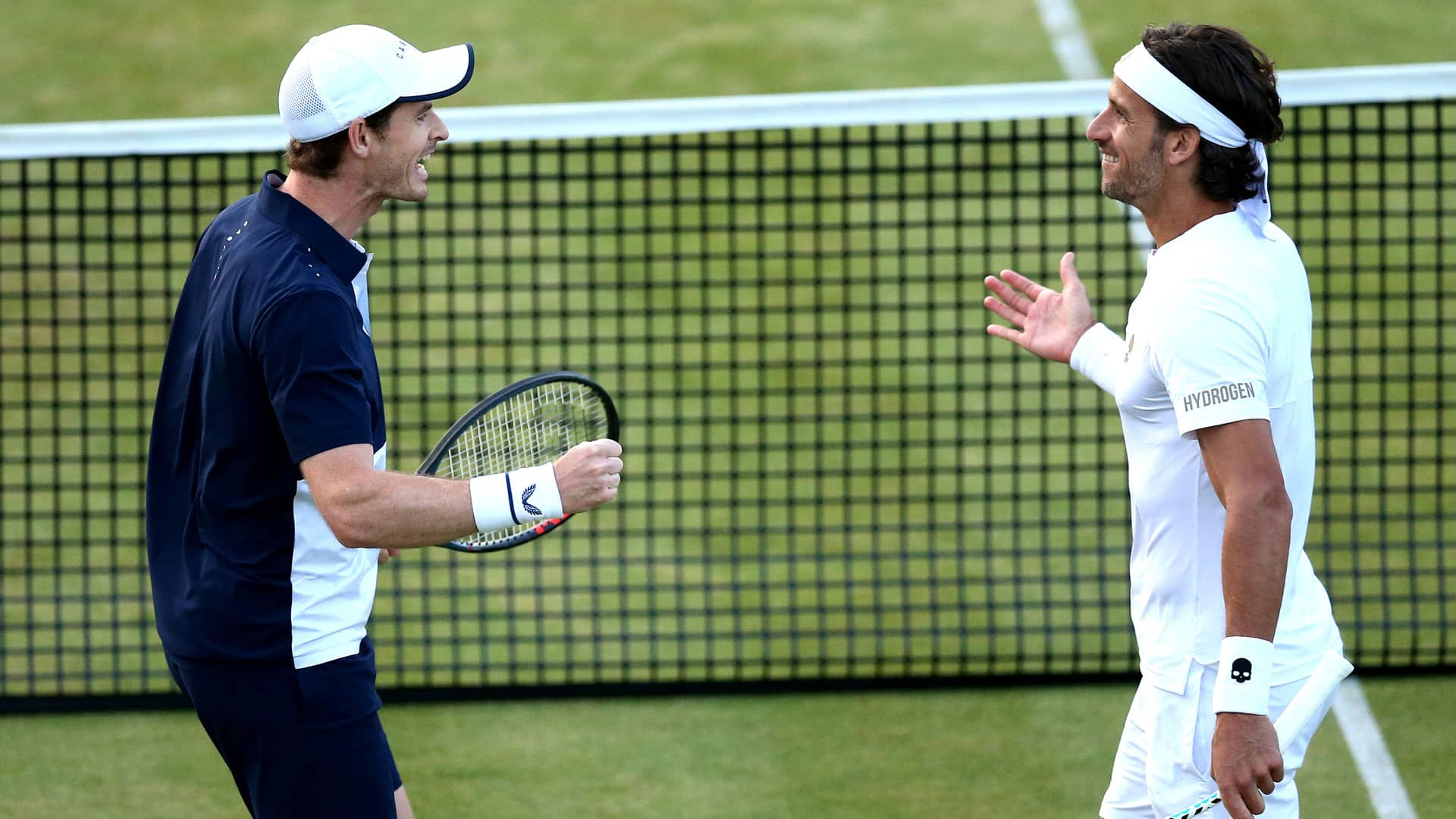 <a href='https://www.atptour.com/en/players/andy-murray/mc10/overview'>Andy Murray</a> and <a href='https://www.atptour.com/en/players/feliciano-lopez/l397/overview'>Feliciano Lopez</a> celebrate at Queen's Club 2019
