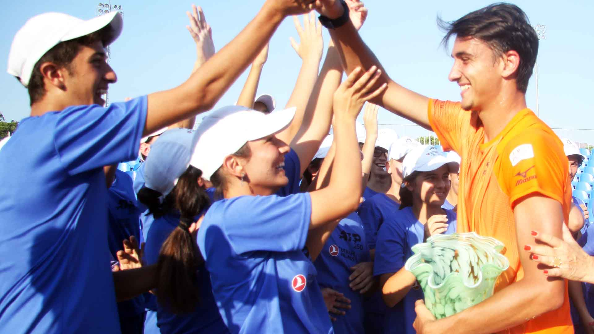 <a href='https://www.atptour.com/en/players/lorenzo-sonego/su87/overview'>Lorenzo Sonego</a> celebrates with ball kids after capturing the <a href='https://www.atptour.com/en/tournaments/antalya/7650/overview'>Turkish Airlines Open Antalya</a> trophy on Saturday.