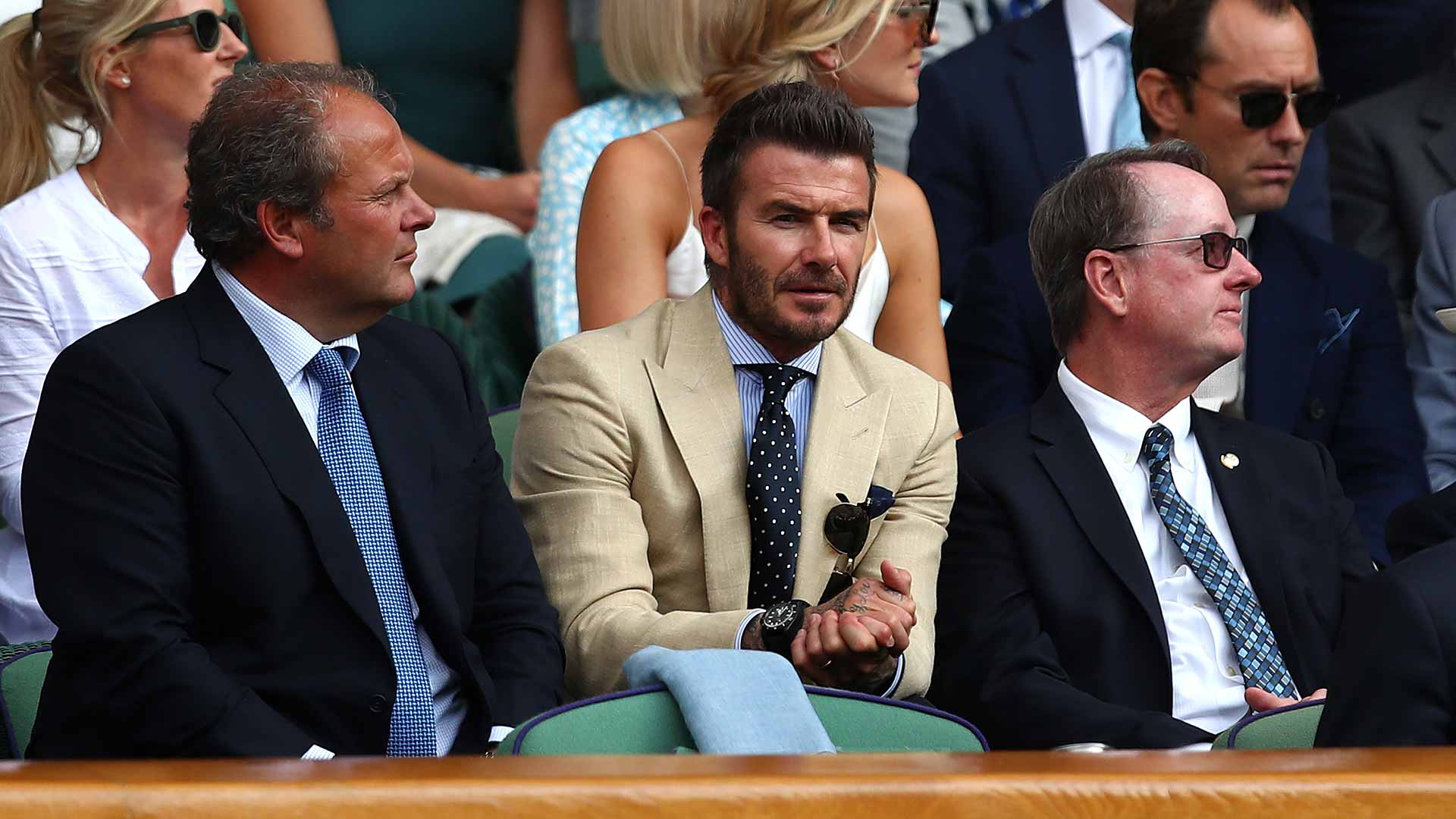 David Beckham watches the semi-final match between Roger Federer and Rafael Nadal at Wimbledon