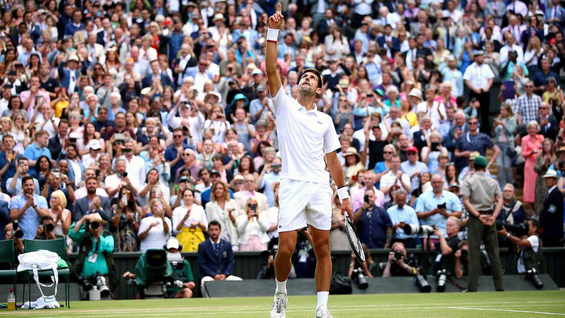 <a href='/en/players/novak-djokovic/d643/overview'>Novak Djokovic</a> celebrates winning his fifth <a href='/en/tournaments/wimbledon/540/overview'>Wimbledon</a> title on Sunday.