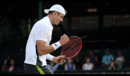 John Isner begins his pursuit of a fourth Newport title with a three-set victory on Wednesday.