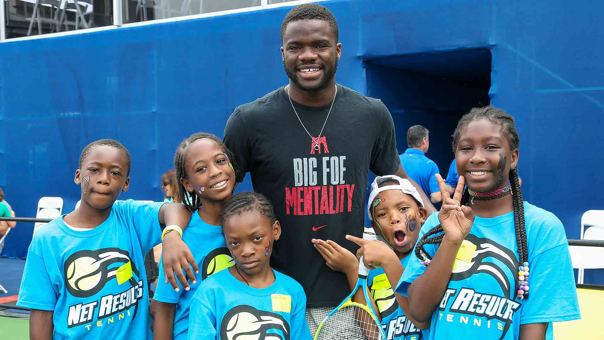 Frances Tiafoe poses for a photo during kids' day at the BB&T Atlanta Open