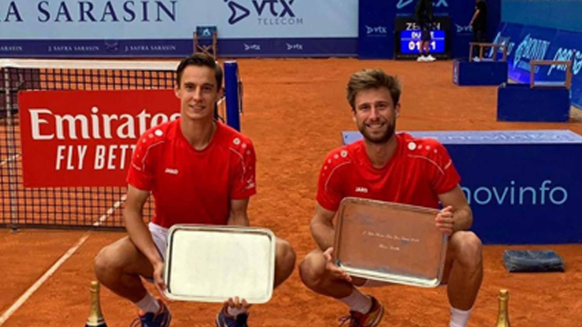 Joran Vliegen, left, and Sander Gille win the Gstaad doubles title on Sunday