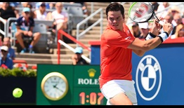 Canadian Milos Raonic opens main draw action at the Coupe Rogers with a straight-sets win over Frenchman Lucas Pouille.