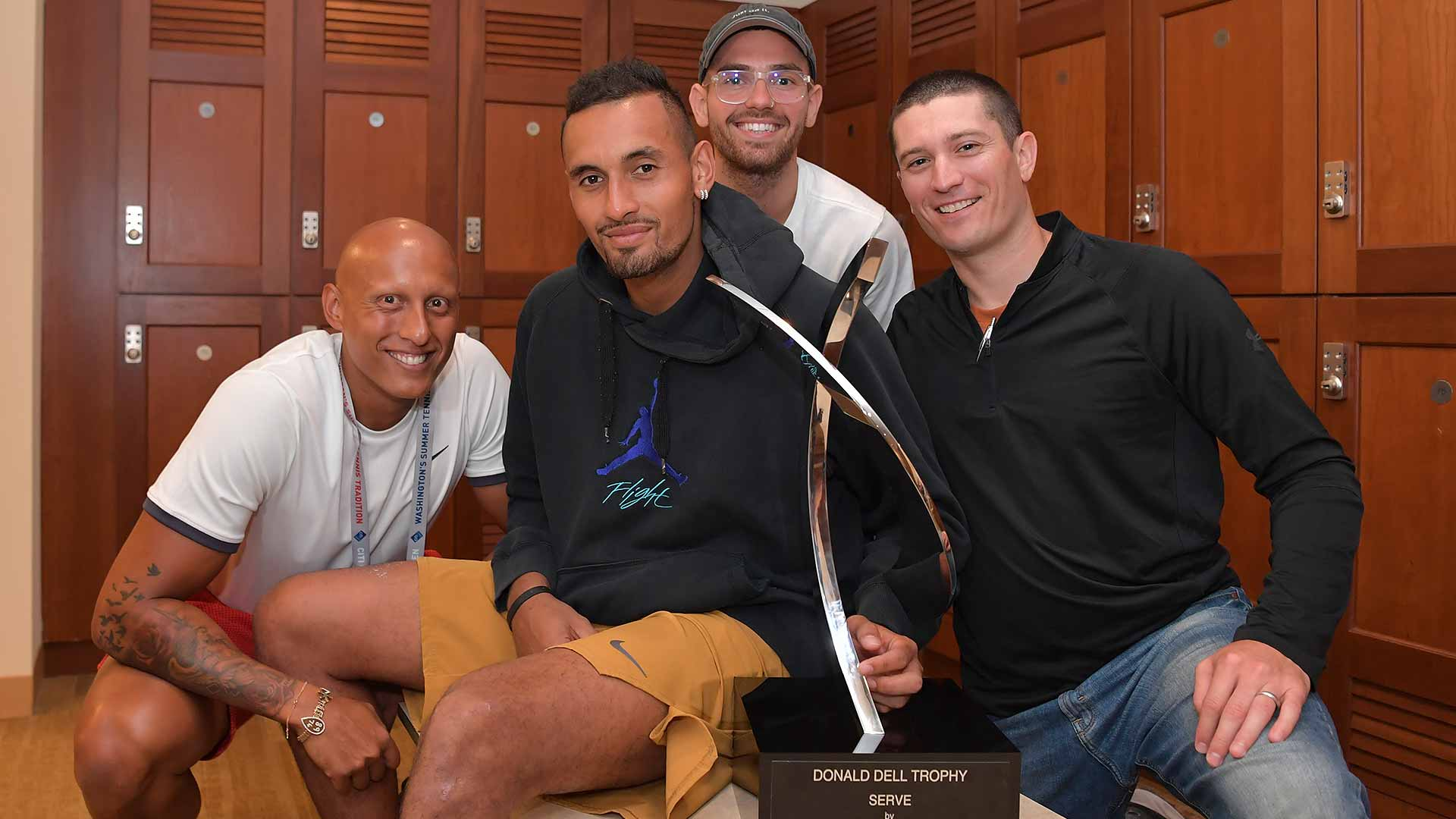 Nick Kyrgios celebrates his Citi Open title with his team on Sunday in Washington, D.C.