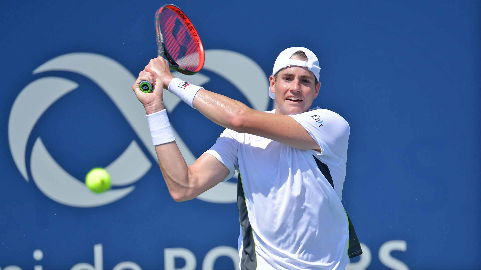 <a href='https://www.atptour.com/en/players/john-isner/i186/overview'>John Isner</a> hits a backhand in Montreal.