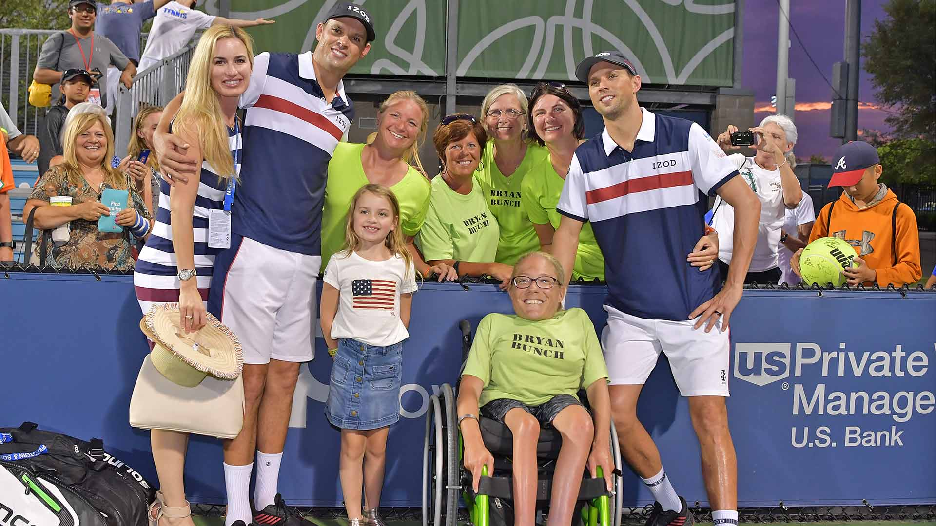Bryan brothers celebrate their 110th team win with family and members of the 'Bryan Bunch'.