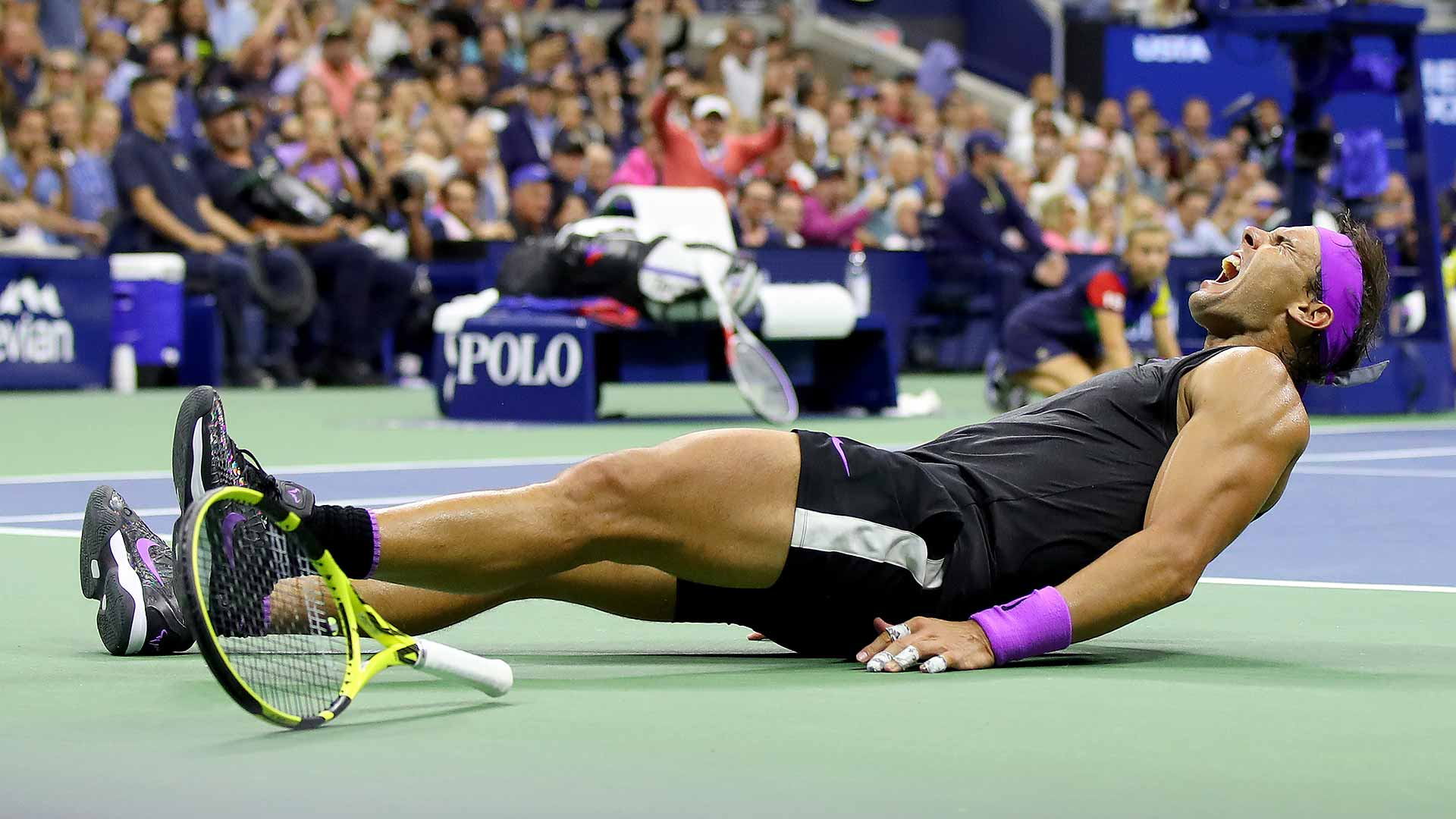 Rafael Nadal collapses after winning his fourth US Open title.