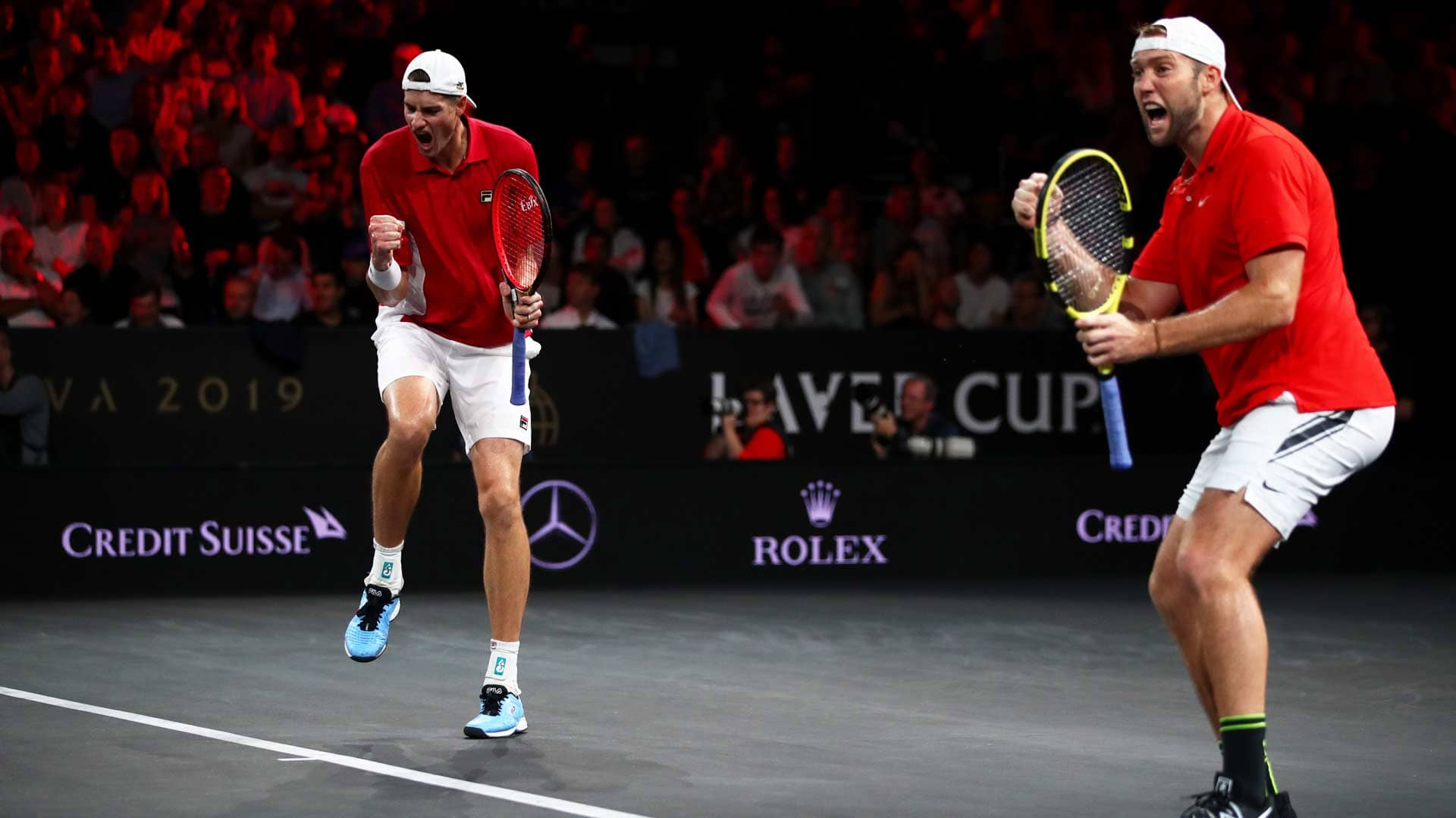 <a href='https://www.atptour.com/en/players/john-isner/i186/overview'>John Isner</a> and <a href='https://www.atptour.com/en/players/jack-sock/sm25/overview'>Jack Sock</a> celebrate at 2019 <a href='https://www.atptour.com/en/tournaments/laver-cup/9210/overview'>Laver Cup</a>