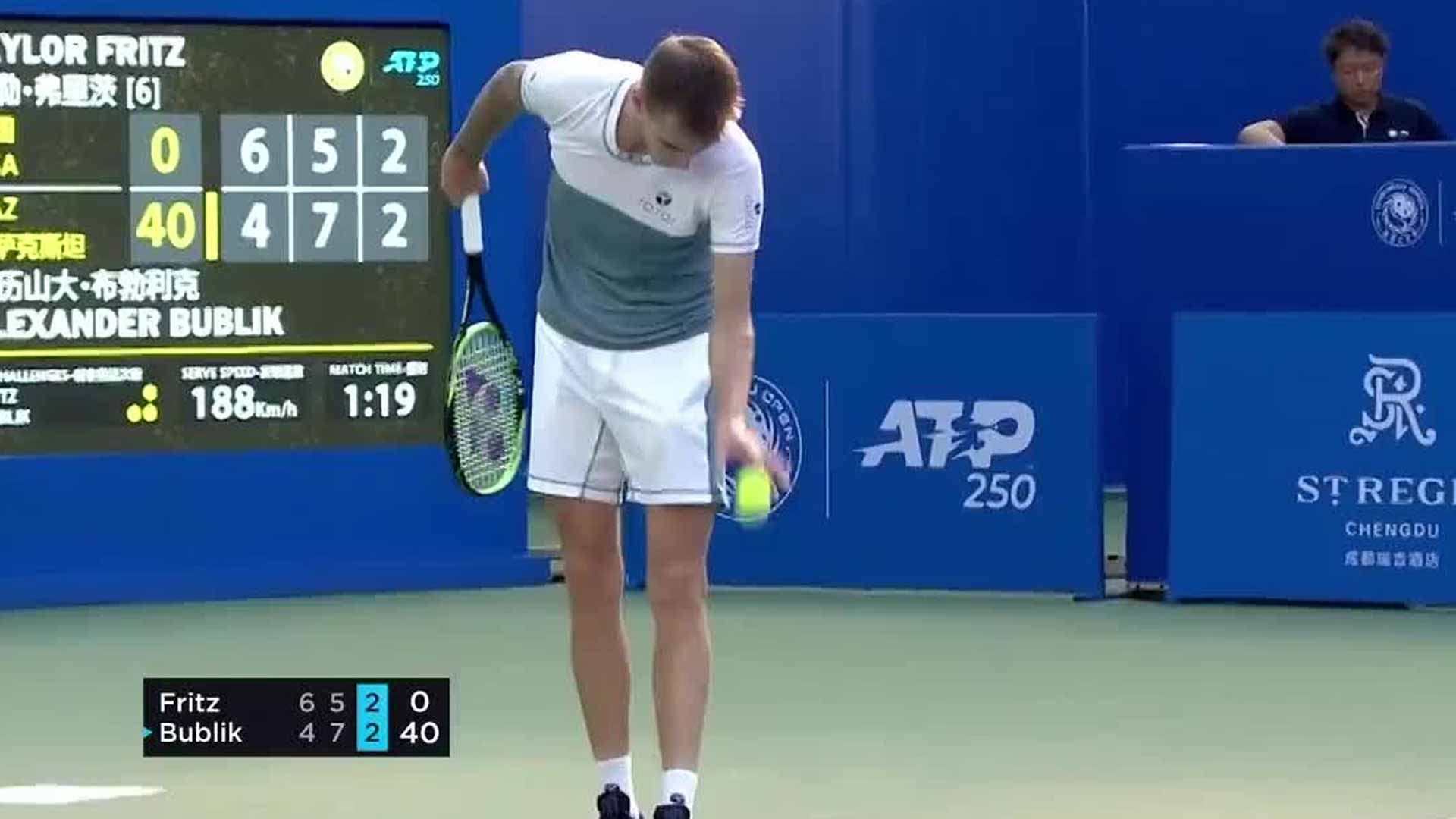 Alexander Bublik hits an underarm serve against Taylor Fritz on Wednesday in Chengdu