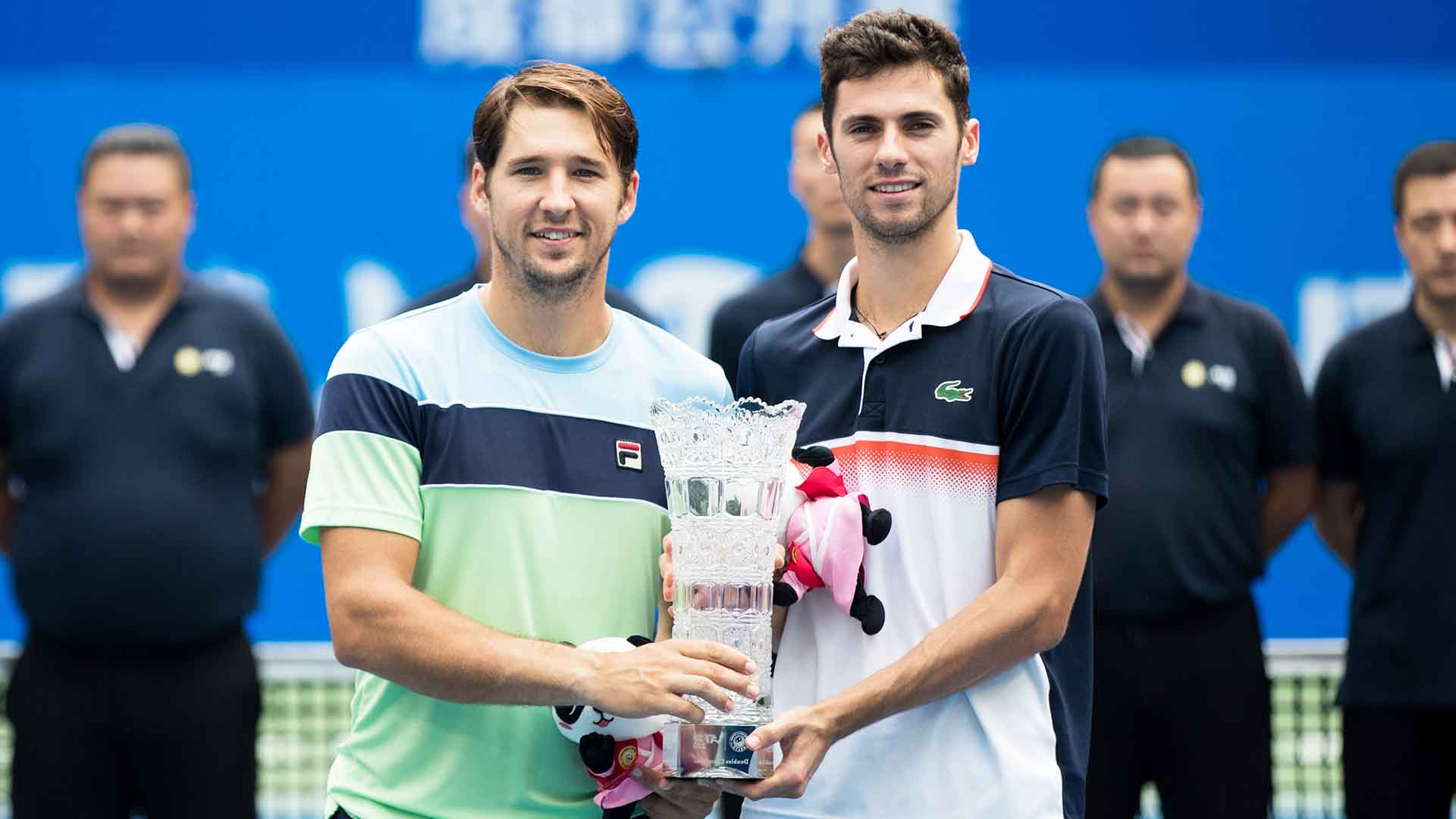 Dusan Lajovic and Nikola Cacic lift their first tour-level trophy as a team.