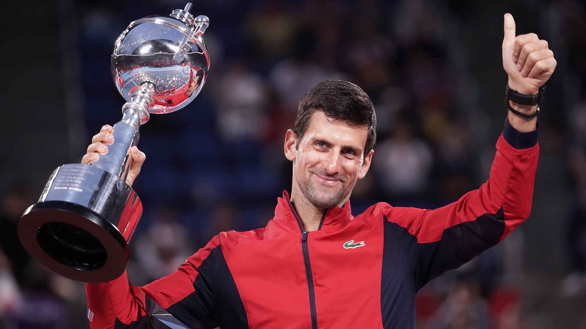 Novak Djokovic defeats John Millman in straight sets to lift the Rakuten Japan Open Tennis Championships trophy on Sunday.