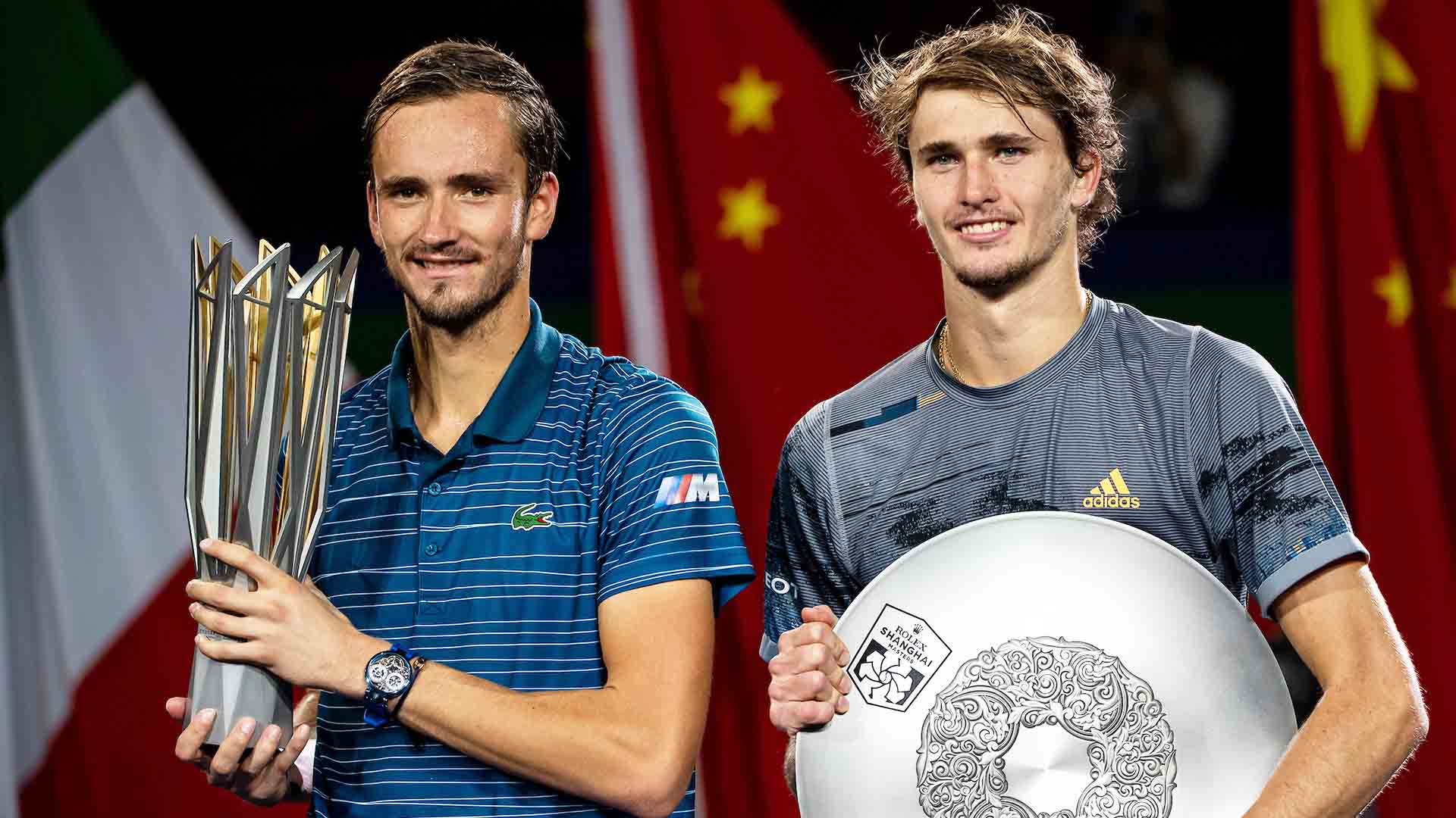 Daniil Medvedev and Alexander Zverev pose for photographs following the Rolex Shanghai Masters final.