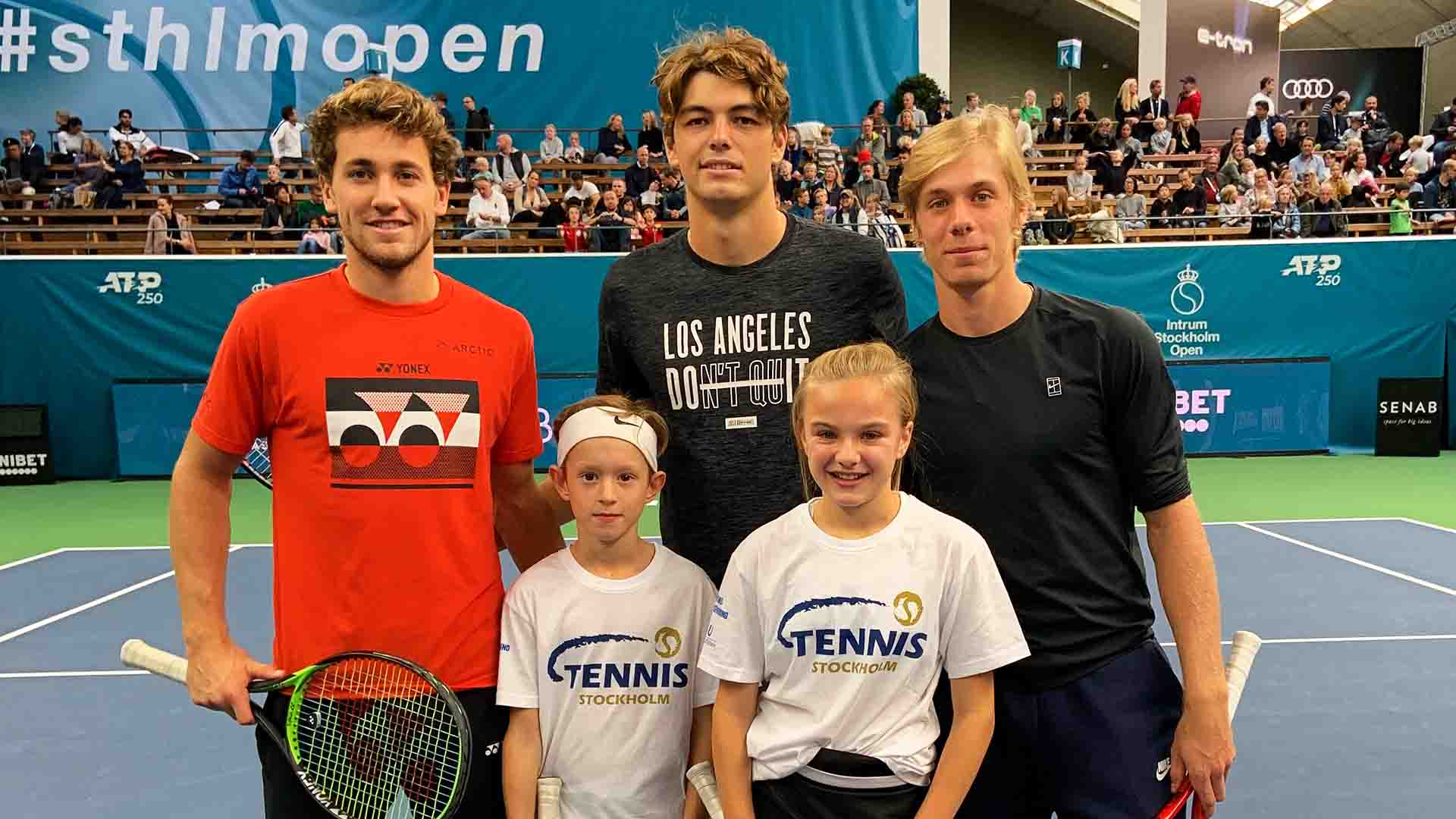 Casper Ruud, Taylor Fritz and Denis Shapovalov meet children at the Intrum Stockholm Open.