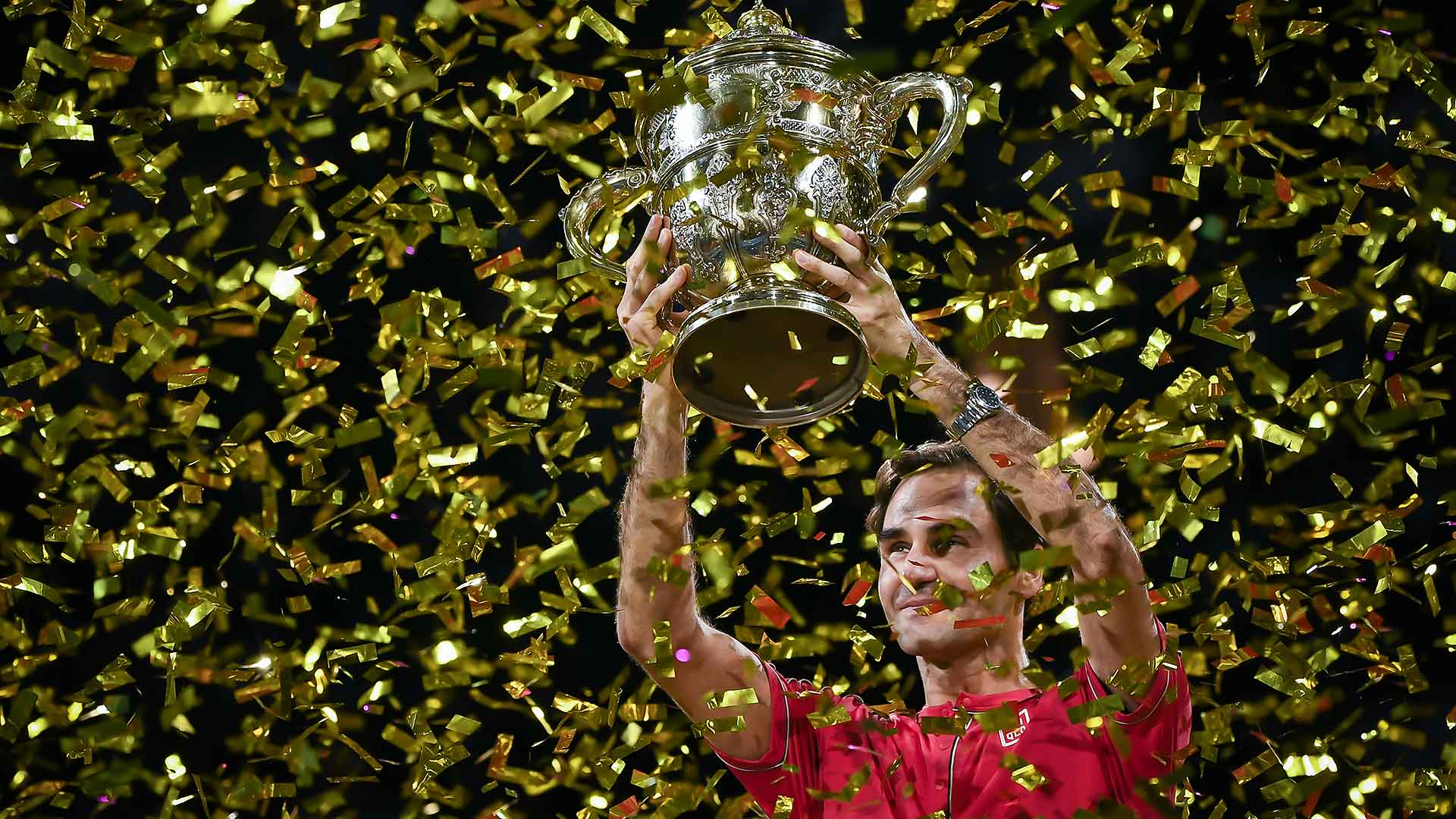 Roger Federer celebrates winning his 10th Basel title