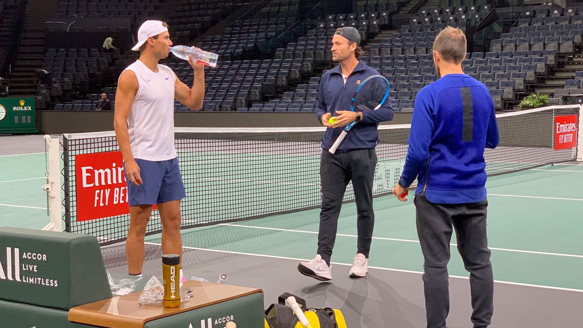 Rafael Nadal takes a break from practice alongside Carlos Moya at the Rolex Paris Masters.