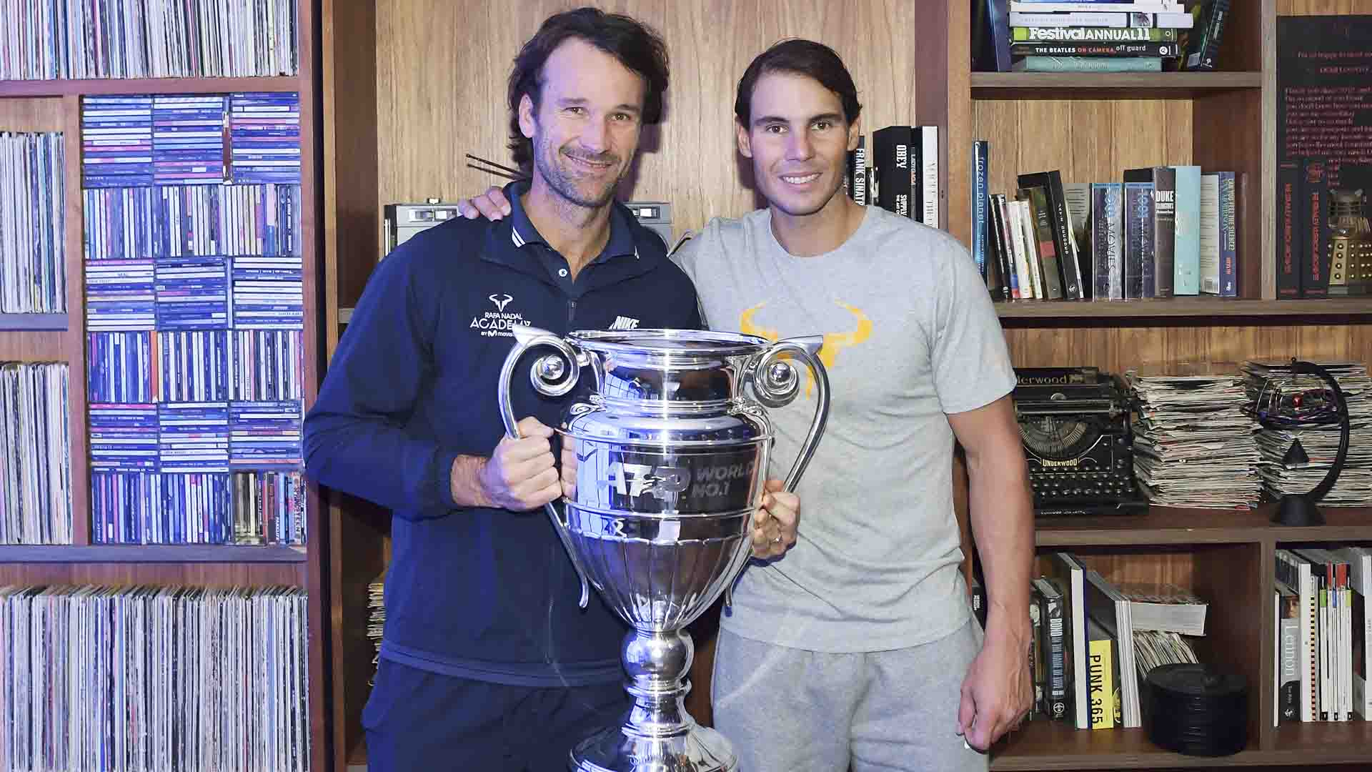 Coach Carlos Moya and Rafael Nadal share a moment with the ATP Tour year-end No. 1 trophy.