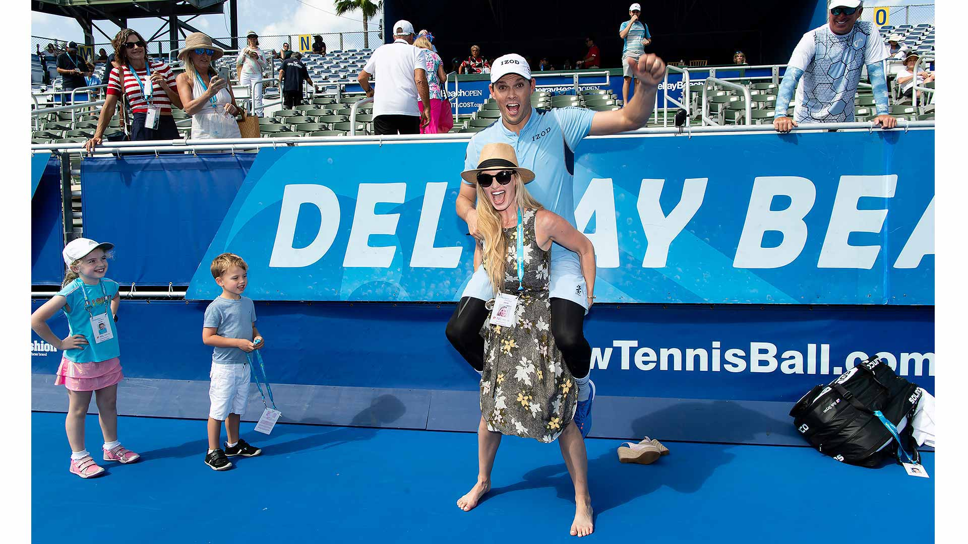 Peter Staples' Best of 2019 pick: <a href='https://www.atptour.com/en/players/bob-bryan/b588/overview'>Bob Bryan</a> receives a piggyback ride from wife Michelle after winning his first title since returning from hip surgery.