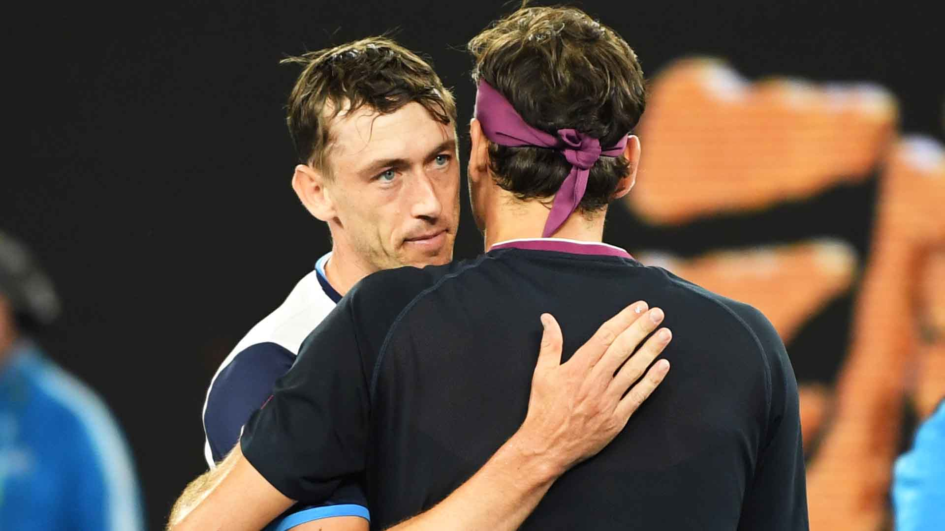 John Millman greets Roger Federer at the net following his five-set loss to the six-time Australian Open champion on Friday.