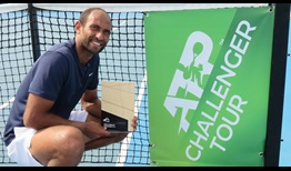 Mohamed Safwat lifts his first Challenger trophy in Launceston, Australia.