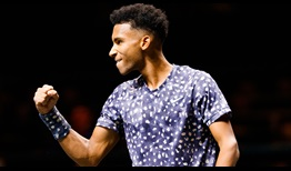 Felix Auger-Aliassime celebrates on Tuesday, but doesn't have things all his own way against Jan-Lennard Struff in Rotterdam.