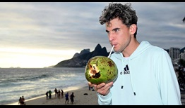 Dominic Thiem takes a drink from a coconut on a visit to Arpoador ahead of the 2020 Rio Open presented by Claro.