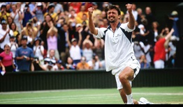 Goran Ivanisevic beats Patrick Rafter in five sets to capture the 2001 Gentlemen's Singles title at Wimbledon.