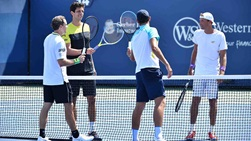 Bruno Soares, Marcelo Melo, Mate Pavic and Lukasz Kubot touch racquets after competing in the first round at the Western & Southern Open.