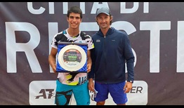 Carlos Alcaraz celebrates his first ATP Challenger Tour title with coach and former World No. 1 Juan Carlos Ferrero.