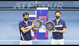 Jurgen Melzer and Edouard Roger-Vasselin beat Marcelo Demoliner and Matwe Middelkoop in the St. Petersburg final to win their first team title.