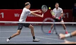 Alexander Zverev and Mischa Zverev save all three break points they face to defeat Dominic Inglot and Aisam-Ul-Haq Qureshi in Cologne.