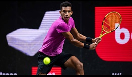 Felix Auger-Aliassime won tie-breaks in the second and third sets to advance in Cologne on Wednesday.
