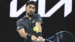 Fabio Fognini saves one match point to defeat countryman Salvatore Caruso in five sets at the Australian Open on Thursday.