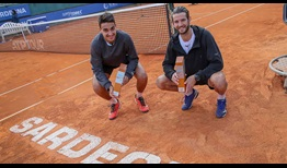 Italians Lorenzo Sonego  (left)and Andrea Vavassori (right) capture the Cagliari doubles title on Saturday.