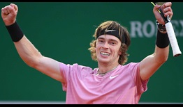 Andrey Rublev sets a quarter-final showdown against Rafael Nadal by clawing past Roberto Bautista Agut on Thursday in three sets.