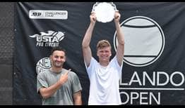 Jenson Brooksby celebrates his second ATP Challenger Tour title in Orlando, alongside coach Nick Bezzubchenko.