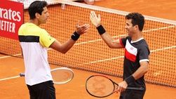 Marcelo Melo and Jean-Julien Rojer saved all seven break points they faced to beat Jamie Murray and Bruno Soares at the Mutua Madrid Open.