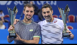 Viktor Troicki and Nenad Zimonjic have clinched a maiden title as a doubles team.