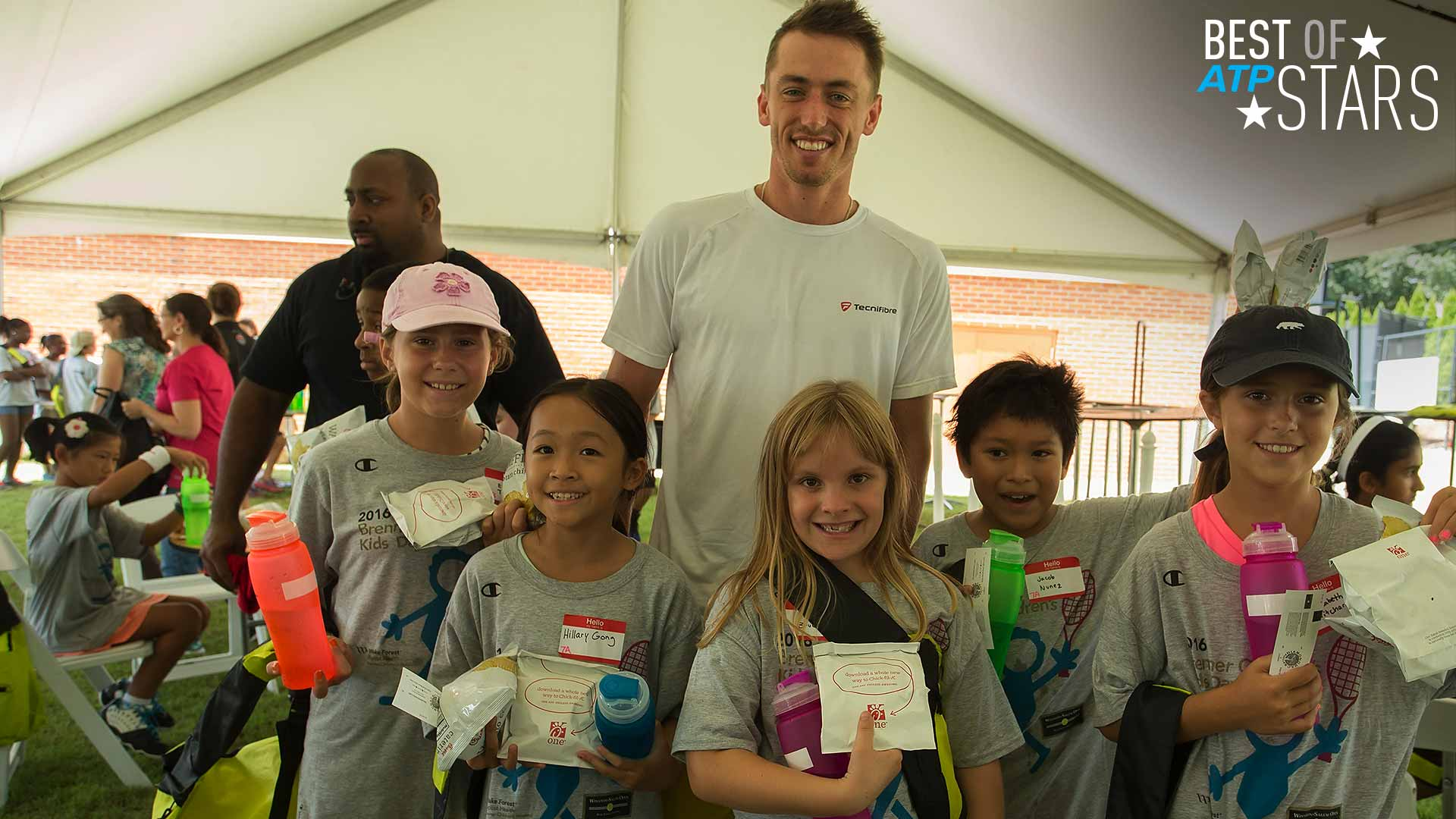 John Millman makes new friends at Kids Day in Winston-Salem.