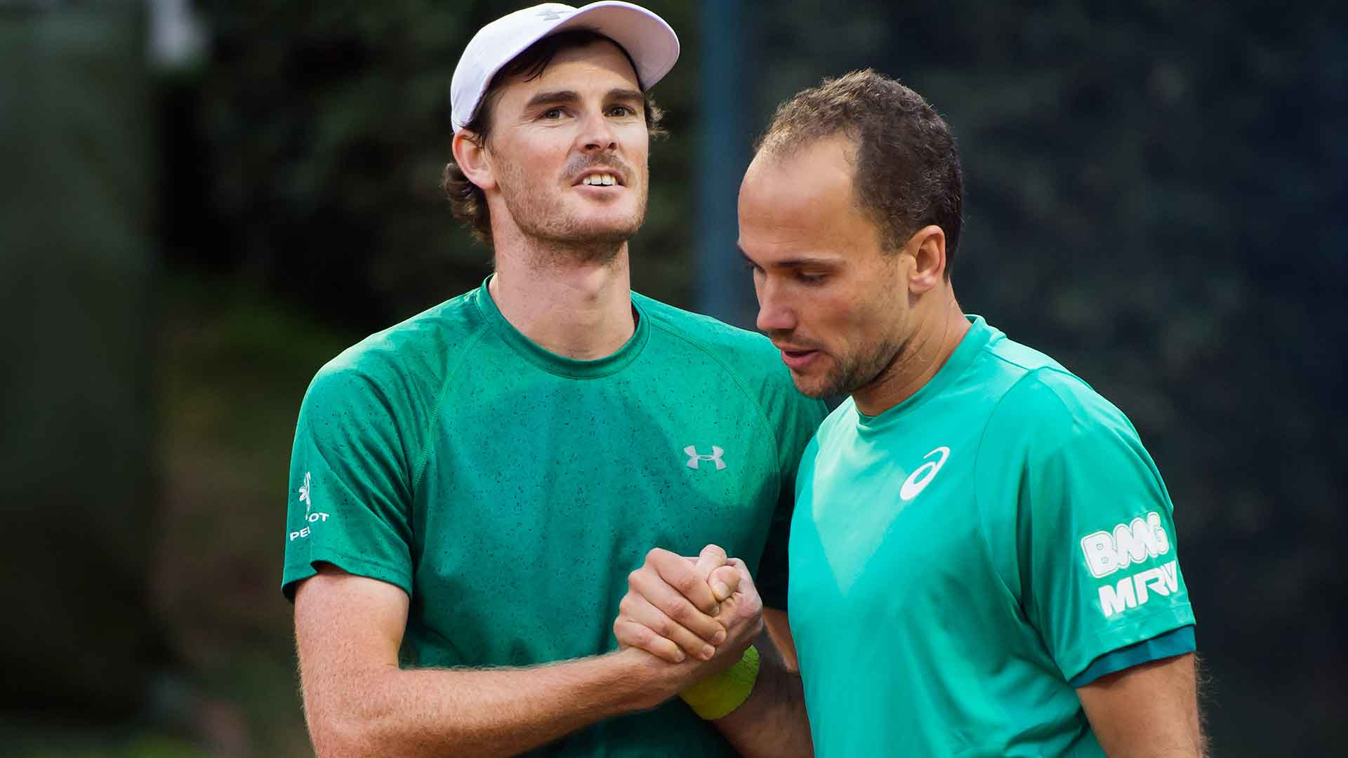 Jamie Murray and Bruno Soares save a match point before advancing to the quarter-finals.