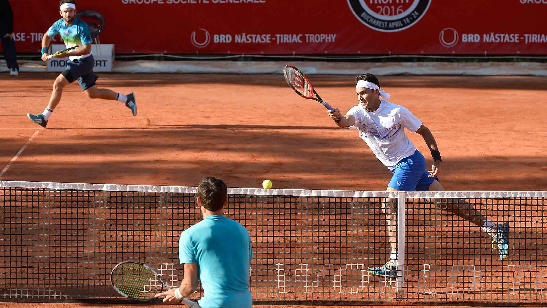 Florin Mergea and Horia Tecau advance at their home tournament in Bucharest.