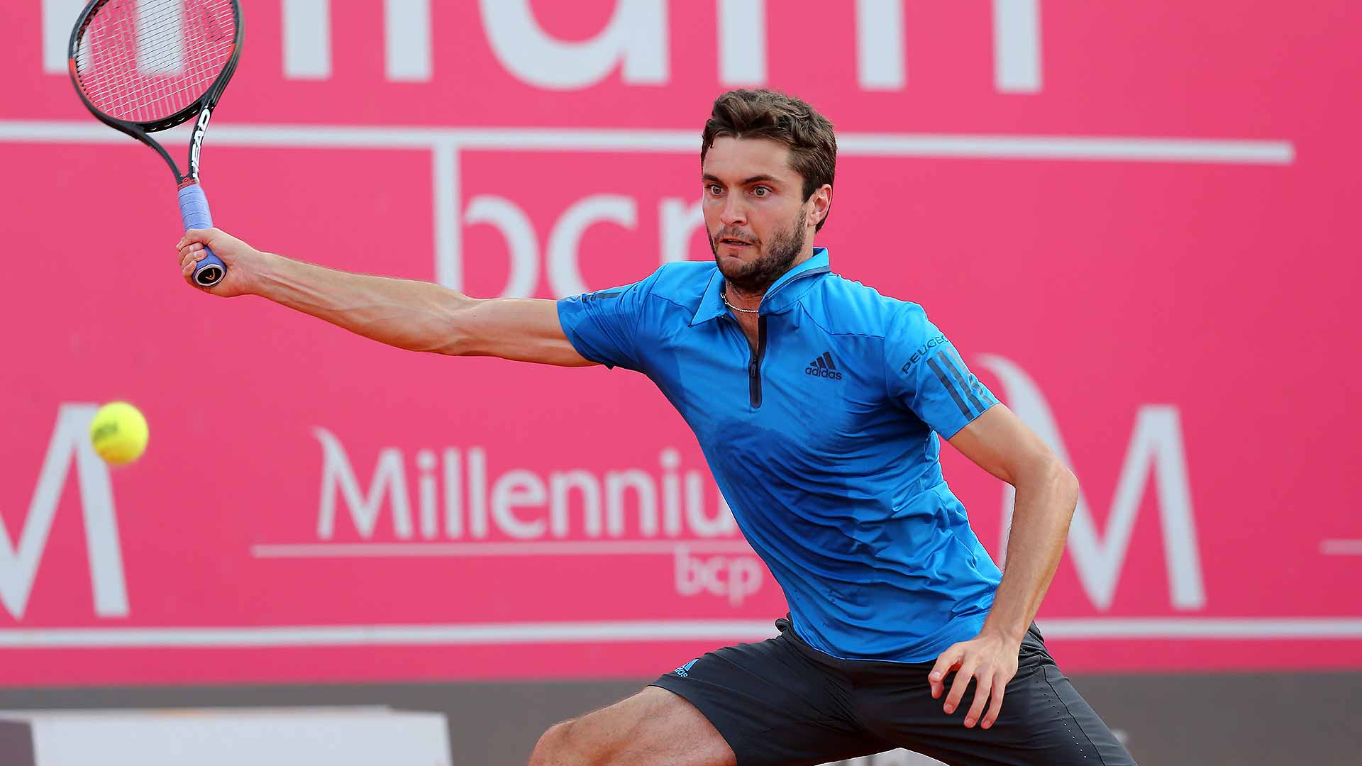 Gilles Simon rallies against Paul-Henri Mathieu to reach the Estoril quarter-finals.