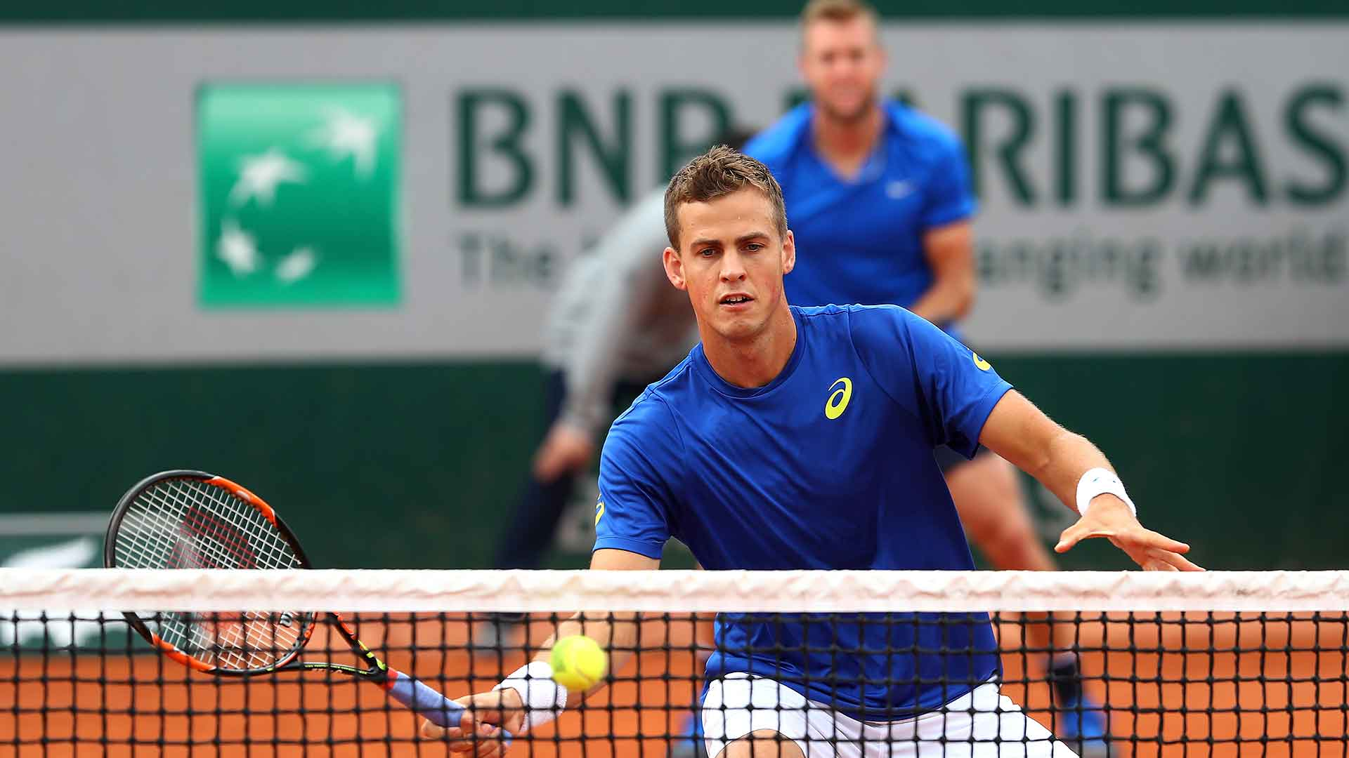 Vasek Pospisil and Jack Sock advance to the second round.