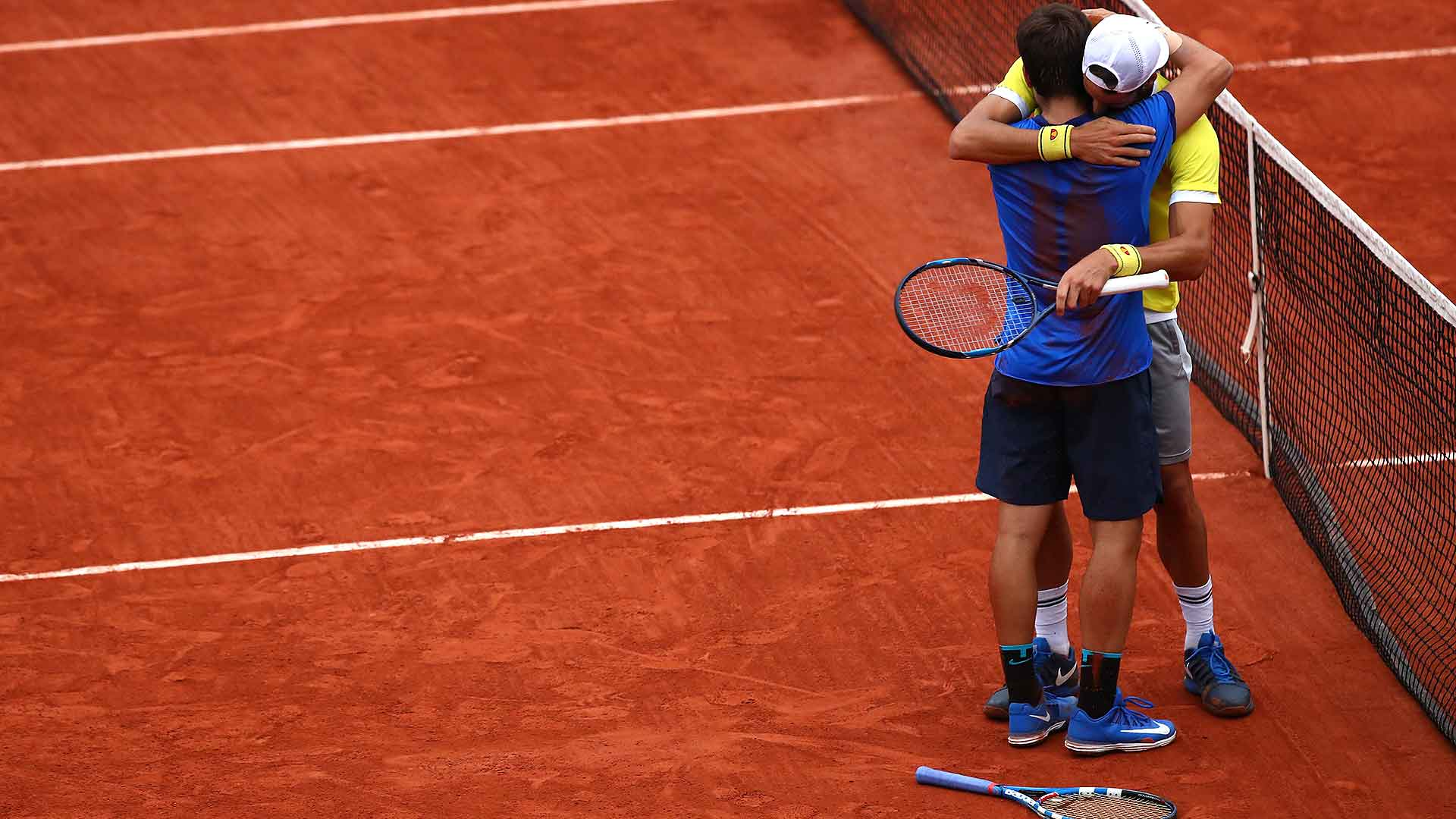 Feliciano and Marc Lopez secure their first team title at Roland Garros.