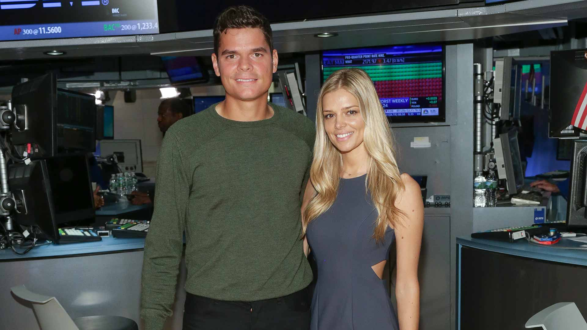 Milos Raonic and girlfriend Danielle Knudson visit the New York Stock Exchange.