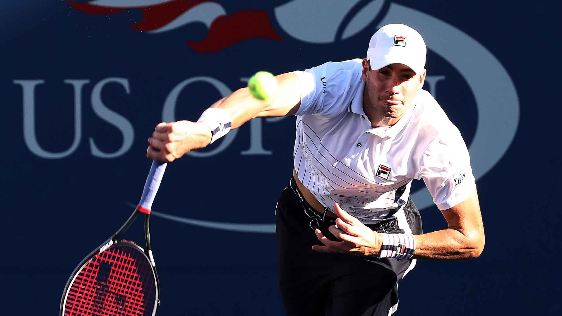 No. 20 seed John Isner rallies from two sets down in the first round against Frances Tiafoe.